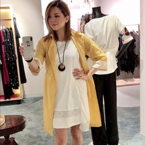 Light weight yellow jacket and white cotton dress